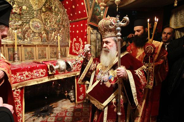 greek orthodox patriarch of jerusalem theophilos iii centre leads the midnight mass at the church of the nativity in the west banks bethlehem as orthodox