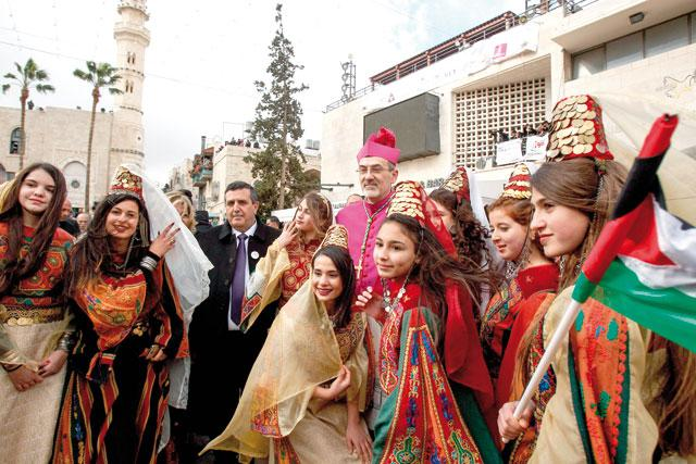 Apostolic Administrator Of The Latin Patriarchate Jerusalem Poses In A Group Photo With Palestinian Women And Girls Dressed Traditional Clothing