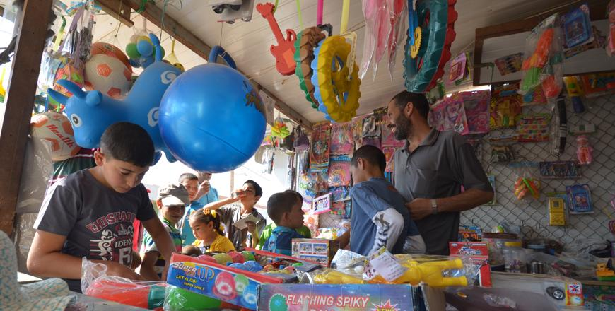 Children At The Zaatari Refugee Camp Some 90km Northeast Of Amman Spend The First Day Of Eid Al Fitr Shopping For Toys And Outside P O By Muath