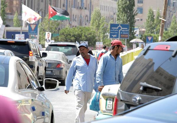 illegal guest workers prohibited from wiring money abroad jordan times rh jordantimes com