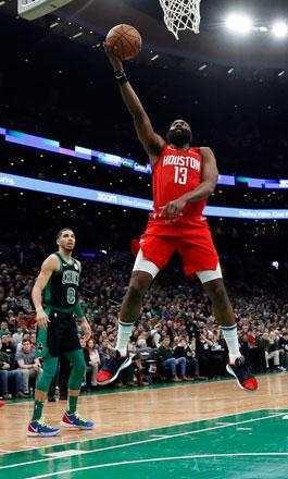 a0d02062d29 Houston Rockets guard James Harden drives uncontested to the basket against  the Boston Celtics during their NBA game in Boston